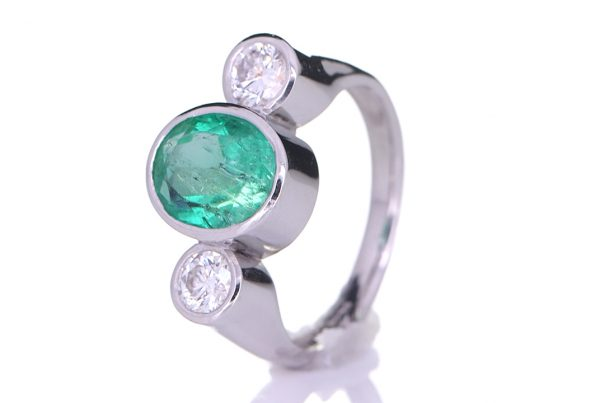 Platinum Ring With Two Diamonds And Green Sapphire