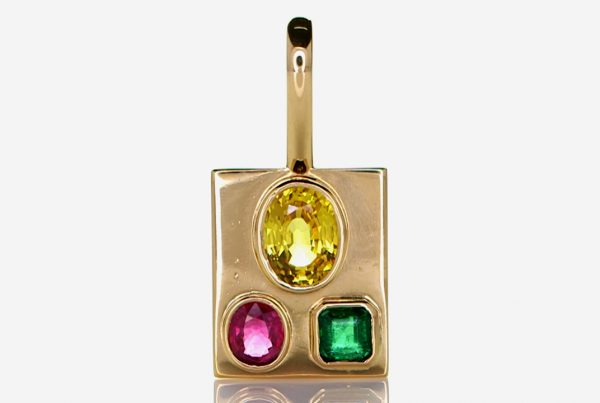 Golden Pendant With Ruby, Yellow Sapphire And A Green Emerald