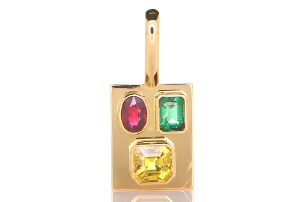 Golden Pendant With Green Emerald, A Ruby. And A Yellow Sapphire
