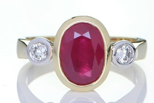 Golden Ring With A Ruby And Two Diamonds