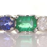 Platinum Ring With A Blue Sapphire, Diamond And An Emerald