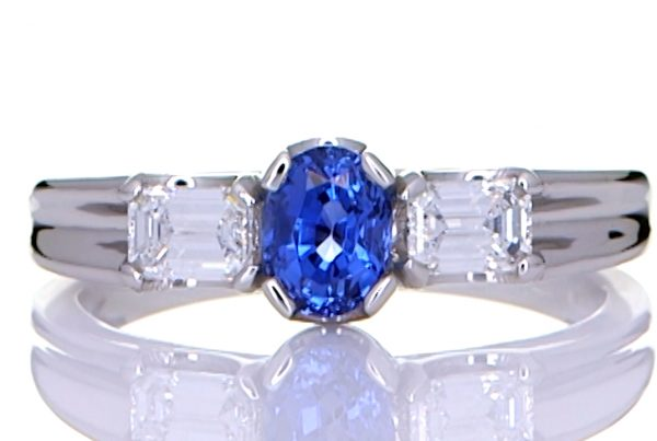 Platinum Ring With A Blue Sapphire With Two Diamonds