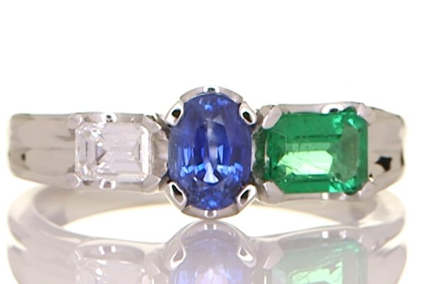 Platinum Ring With A Diamond, Emerald And A Blue Sapphire